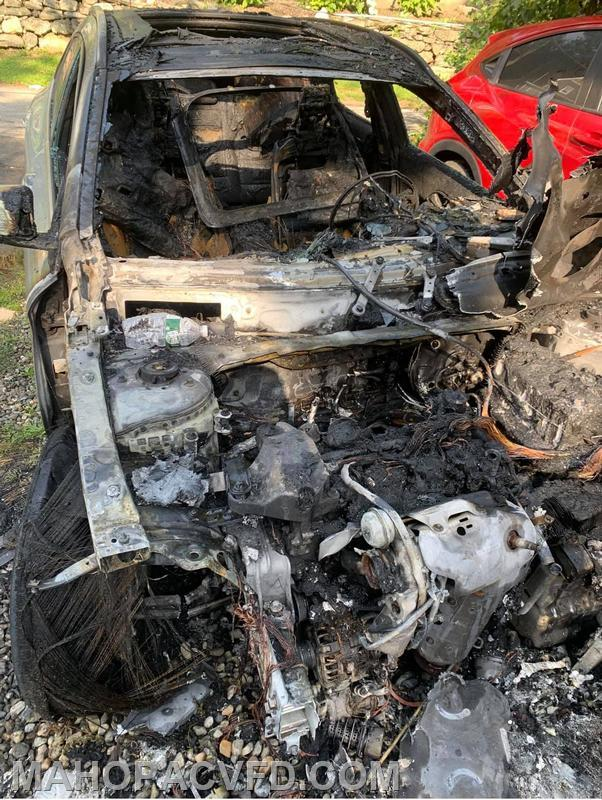 Burnt car that subsequently caught fire.