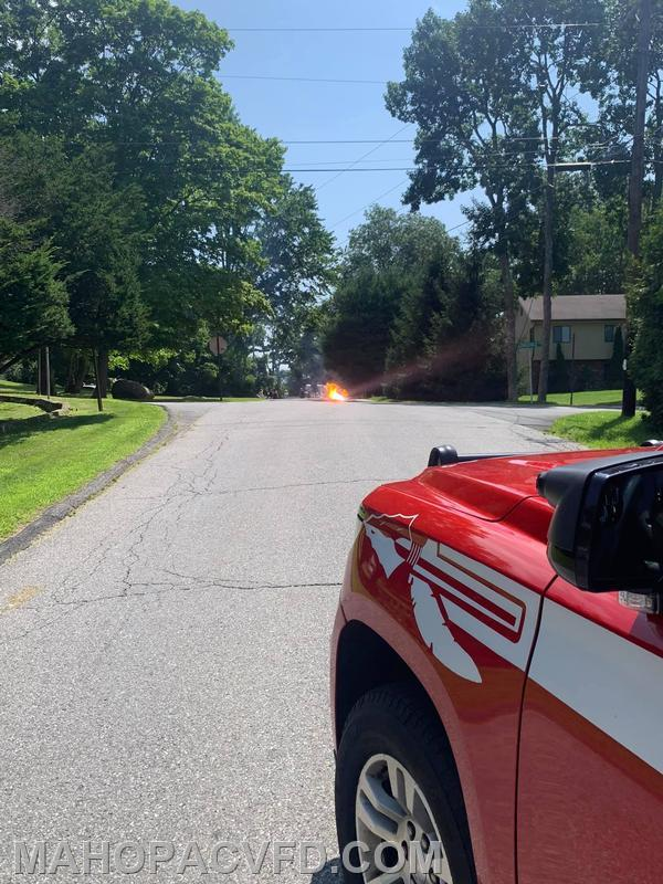 18-1-1 blocking the road at a downed powerline.