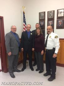 Proud parents pose with their son Newly appointed Carmel Police Officer Brian Smith along with  CPD Chief Cazzeri