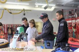 """Carmel Police Officer Neil Brown stands by daughter Quinn as she operates CPR """"Thumper"""""""