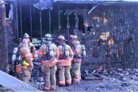 Fire crews assess the damage
