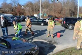 firefighters spread absorbent material to contain the small spill
