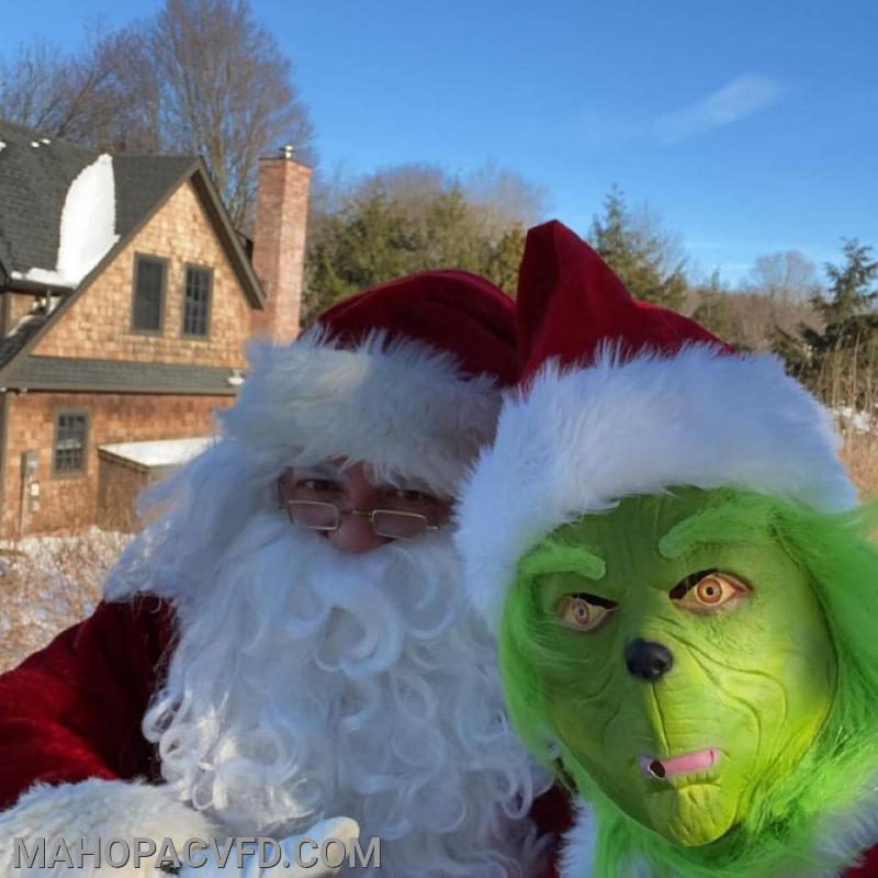 Santa wins over the Grinch and helps spread the Joy!!!