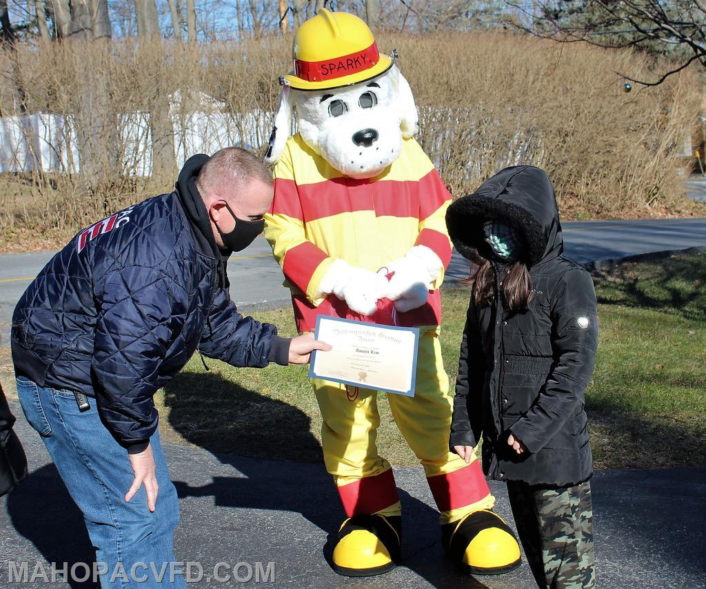 Mahopac Fire Chief and Sparky the Fire Dog introduce themselves to a Town Hero